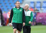 Richard Dunne (left) has been placed on standby by Giovanni Trappatoni, right, for next month's World Cup qualifiers