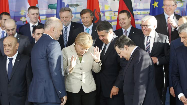 "German Chancellor Merkel reacts as she poses for a group picture at the ""West Balkan Conference"" in Berlin"