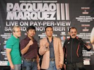 (From L) Pacquiao's trainer Freddie Roach, boxers Manny Pacquiao and Juan Manuel Marquez, and Marquez's trainer Ignacio Beristain, seen here during a press conference in September, ahead of Pacquiao vs Marquez's World Welterweight Championship fight, in New York