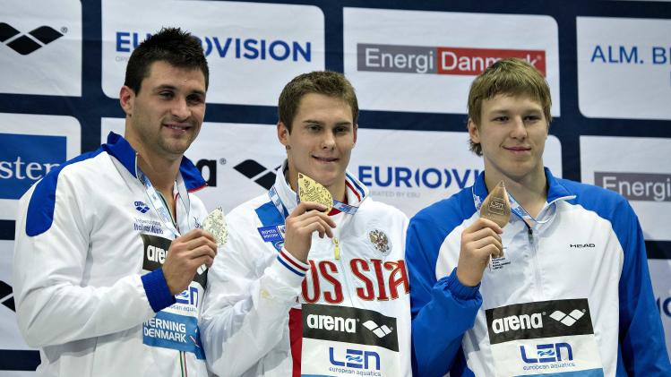 First placed Morozov of Russia, second placed Orsi of Italy and third placed Govorov of Ukraine pose after the men's 50m Freestyle event during the LEN European Short Course Swimming Championship in Herning