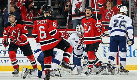 NHL's New Jersey Devils celebrate scoring a goal