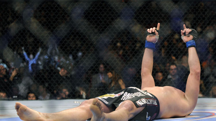 Cain Velasquez of San Jose celebrates after his UFC 155 heavyweight championship mixed martial arts match against Junior dos Santos of Brazil at the MGM Grand Garden Arena Saturday, Dec, 29, 2012 in Las  Vegas. Velasquez won with a unanimous decision. (AP Photo/David Becker)