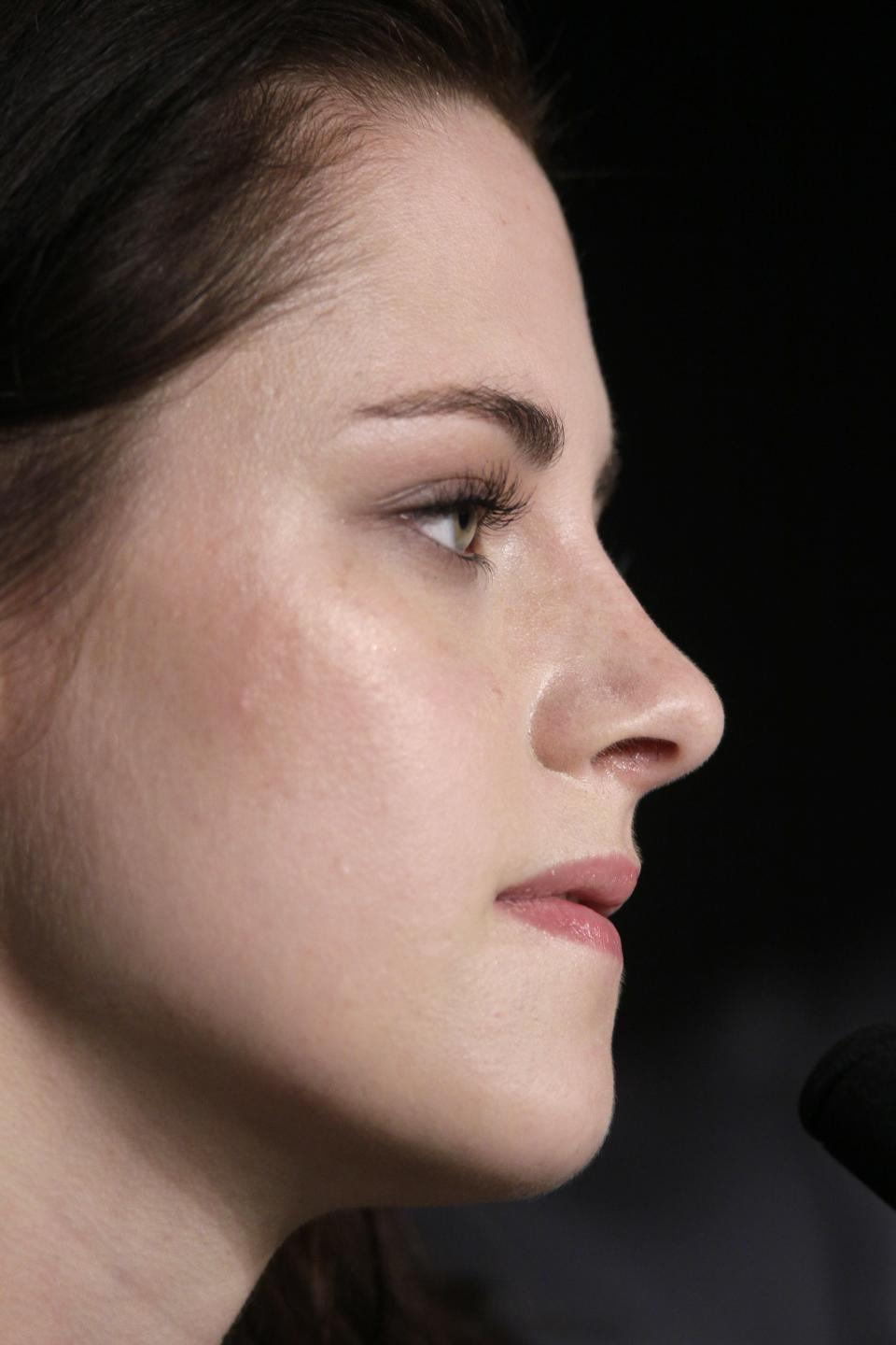 Actress Kristen Stewart listens during a press conference for On the Road at the 65th international film festival, in Cannes, southern France, Wednesday, May 23, 2012. (AP Photo/Francois Mori)