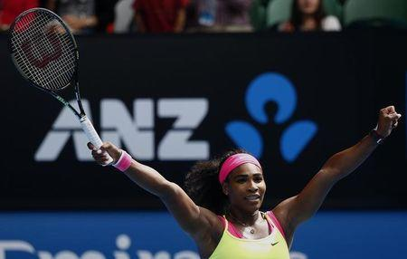 Williams of the U.S. celebrates after defeating Muguruza of Spain in their women's singles fourth round match at the Australian Open 2015 tennis tournament in Melbourne