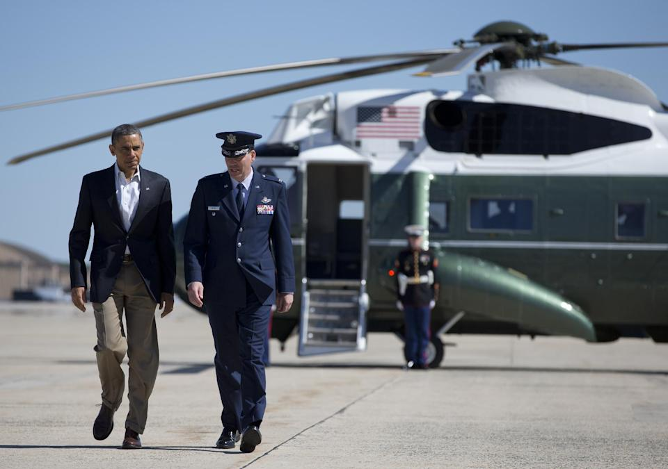President Barack Obama walks with Col. Greg Urtso to board Air Force One, Sunday, May 26, 2013, at Andrews Air Force Base, Md., en route to Moore, Okla., to visit with families and first responders in the wake of the tornadoes and severe weather that devastated the area. (AP Photo/Carolyn Kaster)