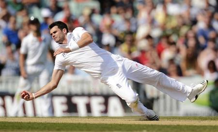 England's Anderson catches Australia's Warner during the fifth Ashes test cricket match in London