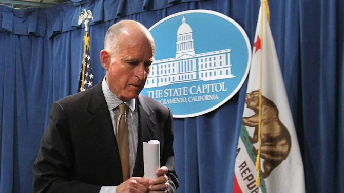 Gov. Jerry Brown leaves a news conference after he unveiled his revised state budget plan at the Capitol in Sacramento, Calif., Monday, May 14, 2012. Brown said the budget shortfall swelled from $9.2 billion predicted in January to $16 billion, in part because tax collections have not come in as high as expected and  lawsuits and federal requirements that have blocked billions of dollars in state cuts. (AP Photo/Rich Pedroncelli)