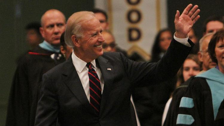 Vice President Joe Biden leads the procession of Tallwood High School staff and students during an afternoon's graduation ceremony at the Virginia Beach Convention Center in Virginia Beach, Va., Thursday, June 14, 2012 . (AP Photo/The Virginian-Pilot, Stephen M. Katz)
