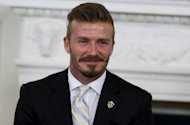 David Beckham, pictured in May 2012, has called on England supporters to stay safe when they travel to Ukraine to watch the team compete at Euro 2012