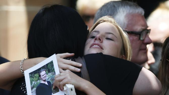 Mourners react as they leave funeral of Sydney cafe siege victim, cafe manager Tori Johnson at St Stephens Uniting Church in Sydney