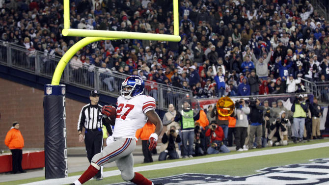 New York Giants running back Brandon Jacobs is alone as he runs into the end zone for a touchdown in the third quarter of an NFL football game against the New York Giants in Foxborough, Mass.. Sunday, Nov. 6, 2011. (AP Photo/Charles Krupa)