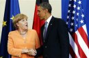 U.S. President Obama and German Chancellor Merkel shake hands at the end of a joint news conference in Berlin