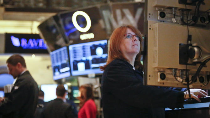 FILE - In this Feb. 20, 2013, file photo, Maureen Smaldone, a trader for Brendan E. Cryan and Company, monitors trading activity from her workstation at the New York Stock Exchange. U.S. stocks are continuing a two-day slide on weak economic data on Thursday, Feb. 21, 2013, and concern that the Federal Reserve may cut back its bond-buying program. (AP Photo/Bebeto Matthews)