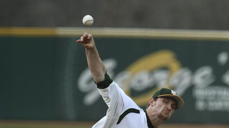 Baylor starting pitcher Dillon Newman throws from the mound against Texas Tech in the first inning of an NCAA college baseball game, Friday, March 14, 2014, in Waco, Texas