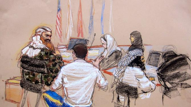In this pool photo of a sketch by courtroom artist Janet Hamlin and reviewed by the U.S. Department of Defense, the self-proclaimed terrorist mastermind Khalid Sheikh Mohammed, left, confers with his lawyer Army Capt. Jason Wright, second from left, as co-defendant Walid bin Attash, second from right, also attends the hearing of the death penalty case against the five Sept. 11 defendants at the Guantanamo Bay U.S. Naval Base in Cuba, Monday, Feb. 11, 2013. (AP Photo/Janet Hamlin, Pool)