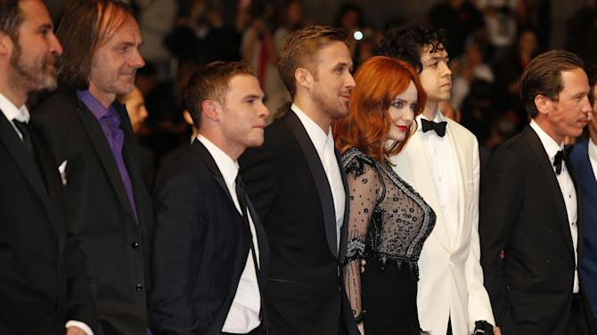 From third left, actor Iain De Caestecker, director Ryan Gosling, actress Christina Hendricks and Geoffrey Arend arrive for the screening of Two Days, One Night (Deux jours, une nuit) at the 67th international film festival, Cannes, southern France, Tuesday, May 20, 2014. (AP Photo/Alastair Grant)