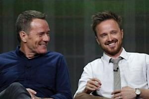 """Cranston smiles with Paul at a panel for the television series """"Breaking Bad"""" during the AMC portion of the Television Critics Association Summer press tour in Beverly Hills"""