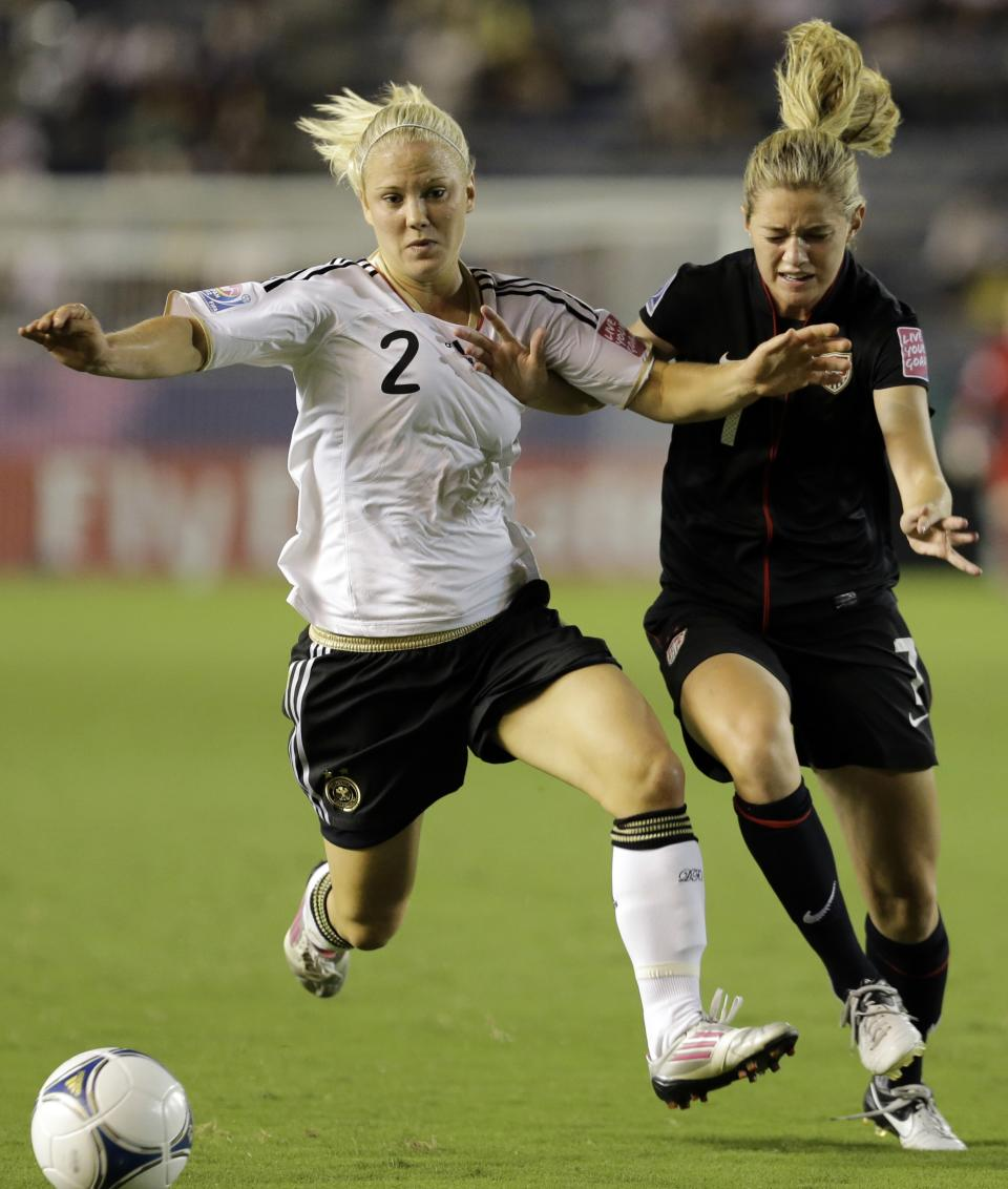 Kealia Ohai, right, of the United States battles for the ball with Leonie Maier of Germany during final match of the U20 Women's World Cup in Tokyo, Saturday, Sept. 8, 2012. (AP Photo/Koji Sasahara)