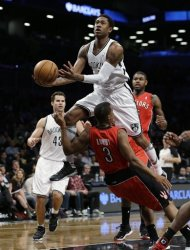 Brooklyn Nets' MarShon Brooks collides with Toronto Raptors guard Kyle Lowry (3) as Lowry draws a foul by Brooks in the first half of an NBA basketball game Tuesday, Jan. 15, 2013, in New York. (AP Photo/Kathy Willens)