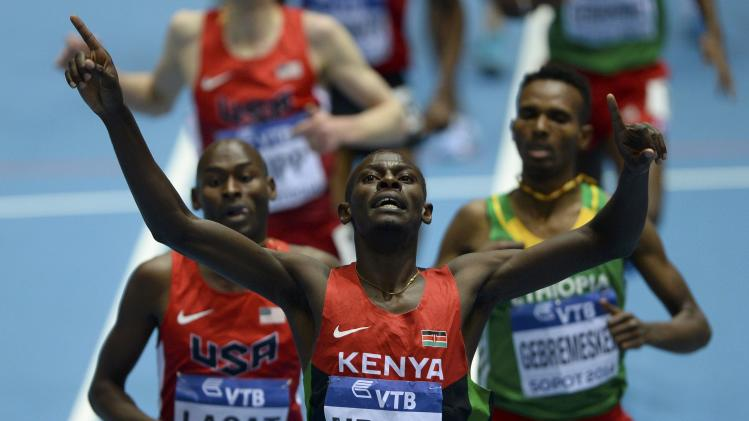 Kenya's Ndiku celebrates as he crosses finish line ahead of Lagat of U.S. and Ethopia's Gebremeskel in men's 3000m final at world indoor athletics championships in Sopot