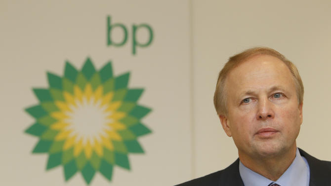 FILE - In this Tuesday, Feb. 1, 2011 file picture, BP PLC's CEO Bob Dudley pauses during a results media conference at their headquarters in London. BP is not fully past the Deepwater Horizon disaster, the 2010 explosion that killed 11 workers and led to the largest oil spill in U.S. history. The company has so far set aside $42 billion to pay fines and damages resulting from the spill, and that amount may yet grow. Paying for the spill has forced BP to change. Under Bob Dudley, who became CEO in October 2010, BP has been selling smaller assets while holding onto promising large resources that it hopes to exploit with its expertise in developing large projects. (AP Photo/Alastair Grant)