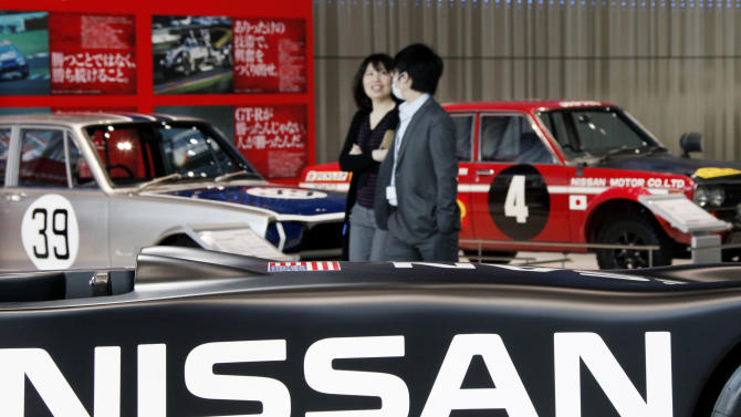 Visitors walk among old and new Nissan racing cars at a gallery inside the headquarters of Nissan Motor Co. in Yokohama, Japan, Friday, Feb. 8, 2013. The Japanese auto maker suffered a 34.6 percent plunge in October-December profit to 54.1 billion yen (US$579 million) as global sales languished, especially in China, where anti-Japanese sentiment flared over a territorial dispute. (AP Photo/Koji Sasahara)