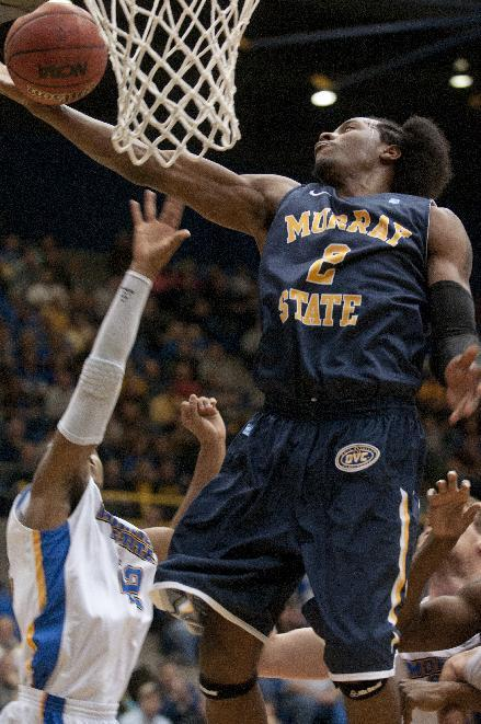 Murray State's Ed Daniel, right, misses a layup attempt Wednesday Jan. 18, 2012, during an NCAA college basketball game against Morehead State in Morehead, Ky.  Murray remains undefeated with the 66-60 win. (AP Photo/John Flavell)