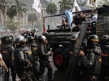 Indonesian police try to disperse supporters of presidential candidate Prabowo Subianto during a protest near the Constitutional Court in Jakarta