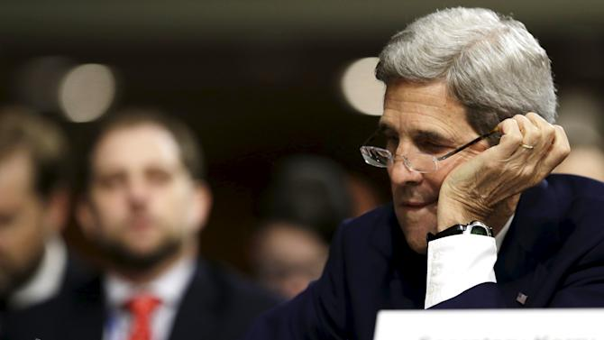 U.S. Secretary of State Kerry checks notes before appearing Senate Armed Services Committee in Washington