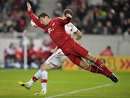 Munich forward Mario Gomez takes a tumble during the German Bundesliga match against Stuttgart on January 27, 2013. Bayern Munich won 2-0 to open up an 11-point lead at the top of the Bundesliga