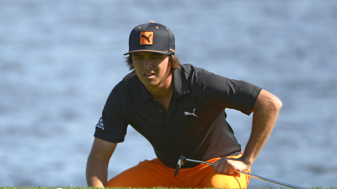 Rickie Fowler lines up a shot on the sixth green during the final round of the Arnold Palmer Invitational golf tournament, Monday, March 25, 2013, in Orlando, Fla. (AP Photo/Phelan M. Ebenhack)