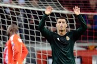 Real Madrid's Cristiano Ronaldo reacts after scoring a goal during the UEFA Champions League Group D match against Ajax Amsterdam, on October 3, at the Arena stadium in Amsterdam. Real won 4-1