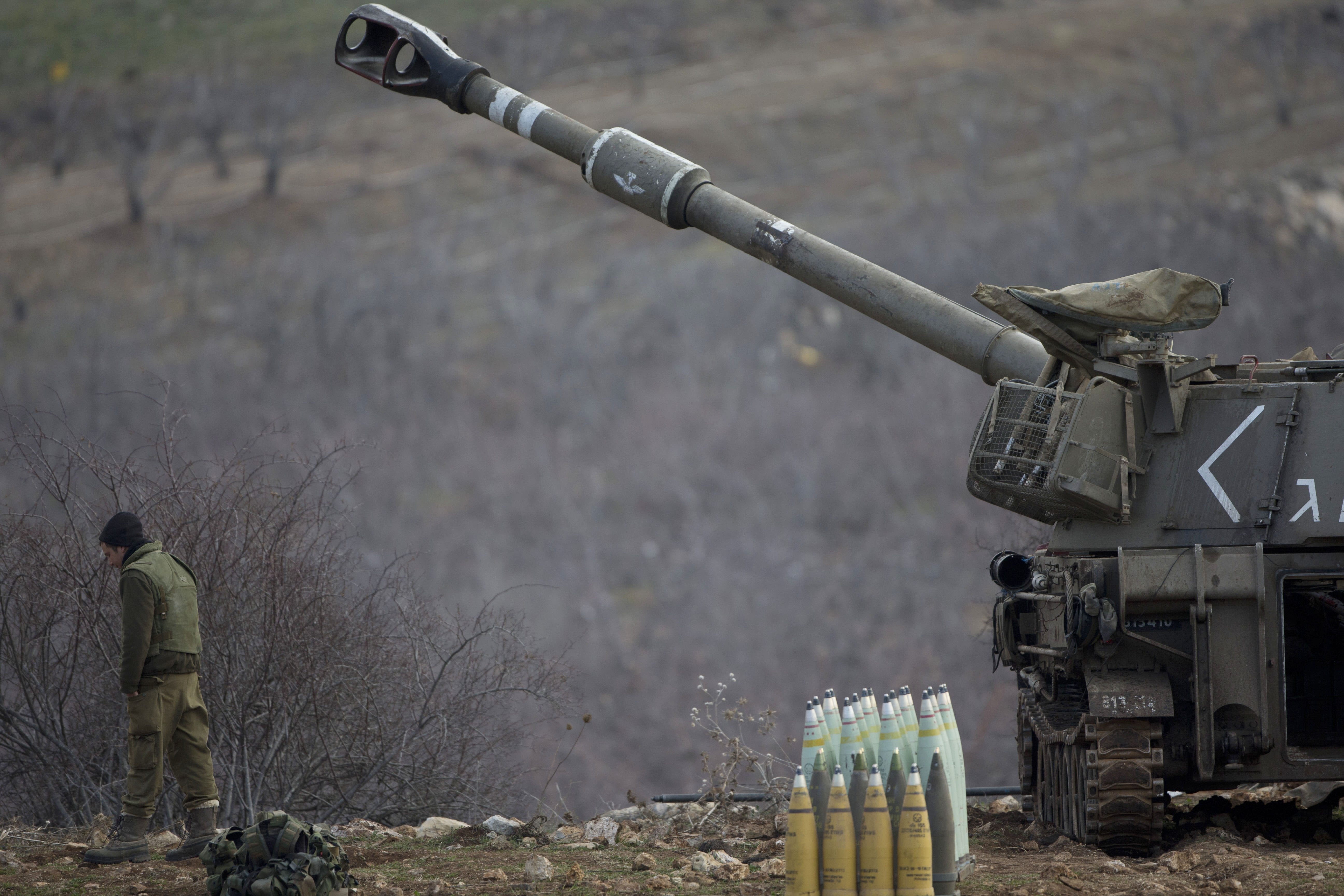 Israel military says its airstrikes target Syrian army posts