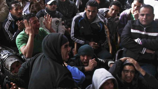 UPDATES DEATH TOLL - Families and supporters of those accused of soccer violence from the Port Said soccer club react to the announcement of verdicts for 21 fans on trial in last years Port Said stadium incident which left 74 people dead, in Port Said, Egypt, Saturday, Jan. 26, 2013. Egyptian security officials say that 38 people have died in the Mediterranean city of Port Said after a judge sentenced 21 people to death in connection to one of the world's deadliest incidents of soccer violence (AP Photo/Mohammed Nouhan, Shorouk Newspaper)   EGYPT OUT