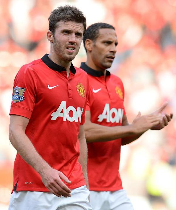 Michael Carrick (left) and Rio Ferdinand leave the pitch after Manchester United lost 1-2 to West Bromwich Albion at Old Trafford on September 28, 2013