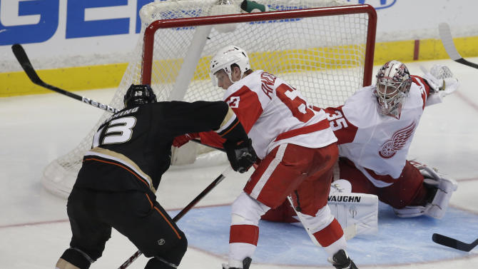 Anaheim Ducks center Nick Bonino, left, scores the winning goal past Detroit Red Wings' Joakim Andersson goalie Jimmy Howard and during overtime in Game 5 of their first-round NHL hockey Stanley Cup playoff series in Anaheim, Calif., Wednesday, May 8, 2013.  The Ducks won 3-2 in overtime.(AP Photo/Chris Carlson)