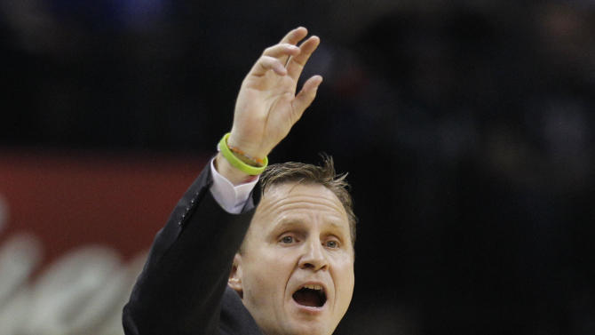 Oklahoma City Thunder coach Scott Brooks shouts to his team in the second quarter of an NBA basketball game against the Los Angeles Clippers in Oklahoma City, Wednesday, Nov. 21, 2012. (AP Photo/Sue Ogrocki)