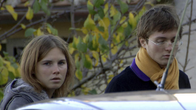 FILE - This Friday Nov. 2, 2007 file photo shows Amanda Knox, left, and Raffaele Sollecito, looking on outside the rented house where 21-year-old British student Meredith Kercher was found dead Friday, in Perugia, Italy. Italy's highest criminal court has overturned the acquittal of Amanda Knox and of her former Italian boyfriend, Raffaele Sollecito, in the slaying of her British roommate and ordered a new trial. The Court of Cassation ruled Tuesday, March 26, 2013 that an appeals court in Florence must re-hear the case against the American and her Italian-ex-boyfriend for the murder of 21-year-old Meredith Kercher  (AP Photo/Stefano Medici, file)