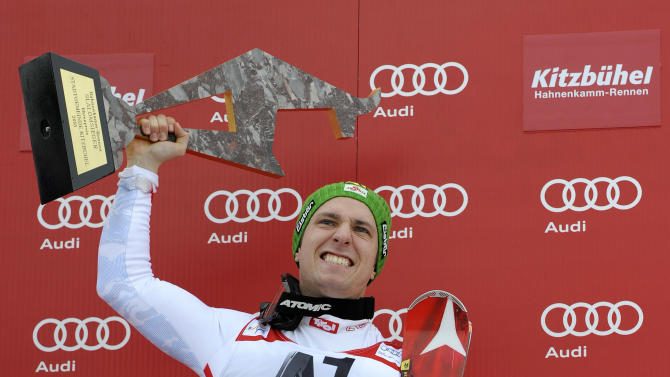 Austria's Marcel Hirscher celebrates on the podium after winning an alpine ski, men's World Cup slalom in Kitzbuehel, Austria, Sunday, Jan. 27, 2013. (AP Photo/Giovanni Auletta)