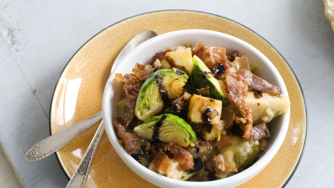 In this image taken Dec. 20, 2012, creamy brown rice risotto two ways recipe for brussels sprouts and apple is shown served in a bowl in Concord, N.H. (AP Photo/Matthew Mead)