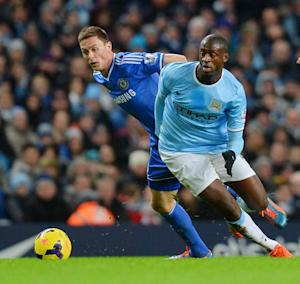 Yaya Toure (right) challenges Chelsea's Nemanja Matic during a Premier League game at the Etihad Stadium in Manchester on February 3, 2014