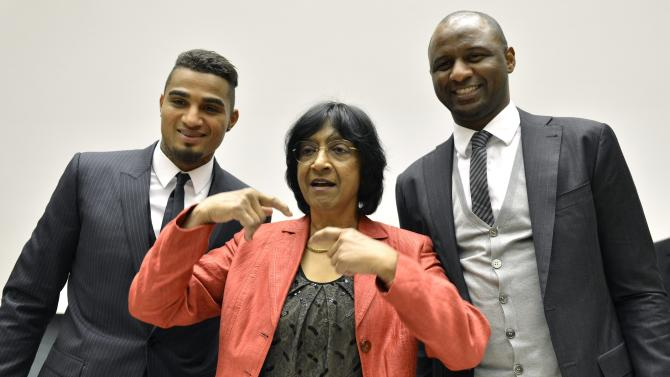 "Ghana's Kevin-Prince Boateng and  AC Milan soccer player, left, U.N. High Commissioner for Human Rights South African Navanethem Pillay, center, and Patrick Vieira, right,  former captain of the French national football team and current Football Development Executive at Manchester City Football Club, pose for a photographers prior to a panel discussion on Racism and Sport during the World Humanitarian Day at the European headquarters of the United Nations in Geneva, Switzerland, Thursday, March 21, 2013. The Office of the High Commissioner for Human Rights hosts a panel discussion on ""Racism and Sport"".  (AP Photo/Keystone/Martial Trezzini)"