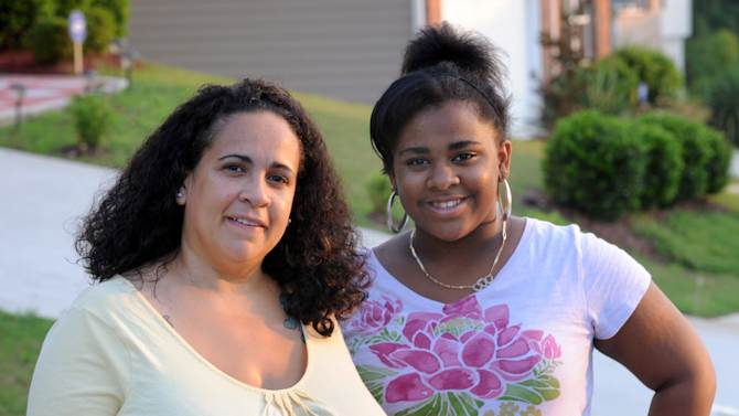 In a July 11, 2011 photo, Stormy Bradley, left, and her daughter Maya, 14, are seen, in Atlanta. Maya is part of an anti-obesity ad campaign in Georgia. A provocative article in a prominent medical journal argues that parents of extremely obese children should lose custody because they can't control their kids' weight in the most extreme cases. Bradley's daughter isn't at risk, but Bradley sympathizes with parents struggling to control their kids' weight. (AP Photo/Erik S. Lesser)