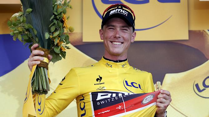 BMC Racing rider Dennis of Australia wears the race leader's yellow jersey after wining the first stage of the Tour de France