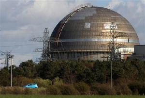 File photograph shows a car passing the Sellafield nuclear reprocessing site near Seascale in Cumbria, England