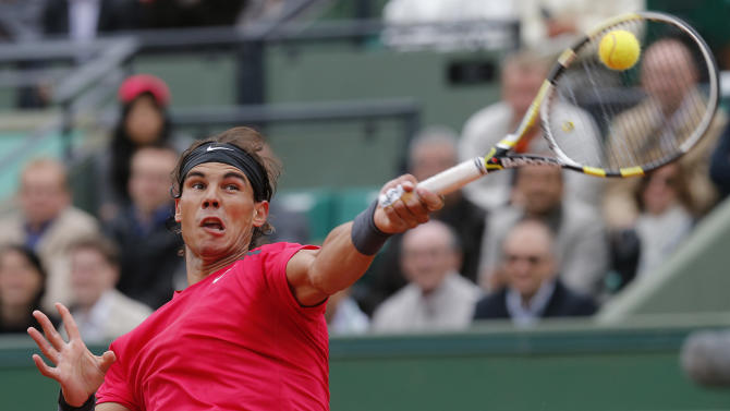 Spain's Rafael Nadal returns the ball to Argentina's Juan Monaco during their fourth round match in the French Open tennis tournament at the Roland Garros stadium in Paris, Monday, June 4, 2012. (AP Photo/Michel Euler)