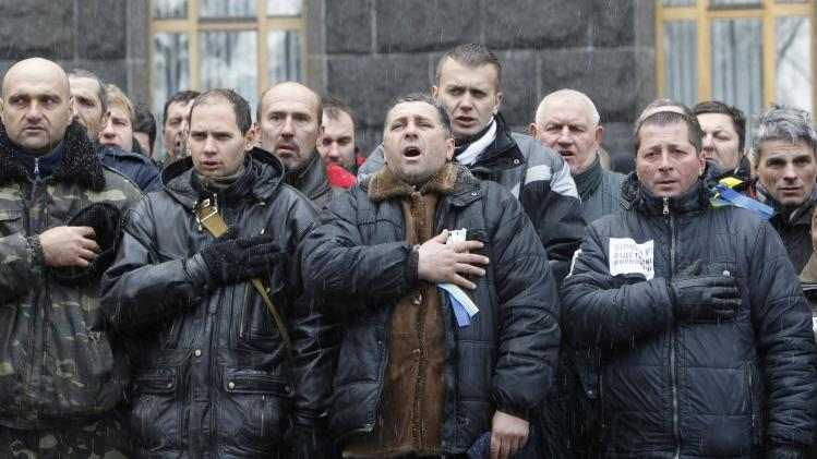 People sing the national anthem during a rally to support EU integration in Kiev