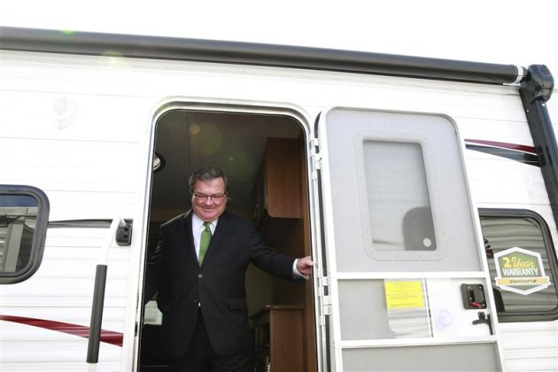 Canada's Finance Minister Jim Flaherty steps out of a recreational vehicle after making an announcement in Ottawa September 9, 2013. REUTERS/Blair Gable