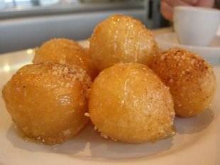 These Loukoumades are deep fried, then soaked in sugary syrup or honey
