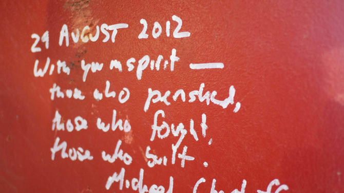 This Jan. 15, 2013 photo shows graffiti left by Michael Chertoff, the former director of Homeland Security, on a steel column on the 104th floor of One World Trade Center in New York. Construction workers finishing New York's tallest building at the World Trade Center are leaving their personal marks on the concrete and steel in the form of graffiti. (AP Photo/Mark Lennihan)